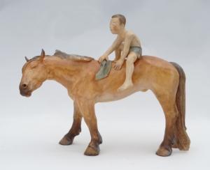 Cheval orange avec son cavalier
