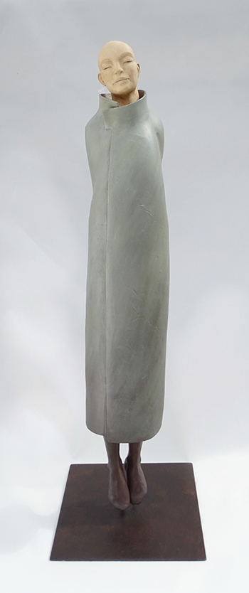 Lévitation, sculpture en argile d'un moine bleu